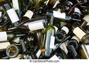 Empty wine bottles - A large heap of empty green wine...
