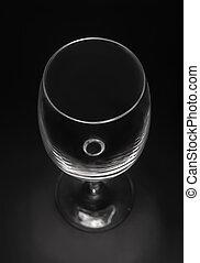 empty wine glass on a black background