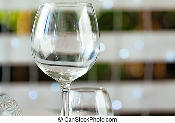 Empty wine glass on a restaurant table