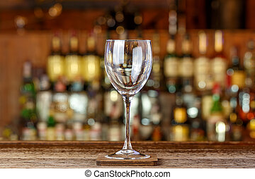 Empty wine glass on the bar