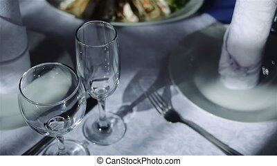 empty wine glasses on a festive table in the restaurant