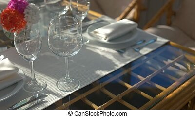 Empty wineglasses and plates. Silverware on white...