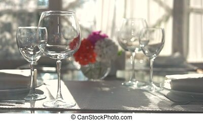 Empty wineglasses on dining table. Glasses, tablecloth and...