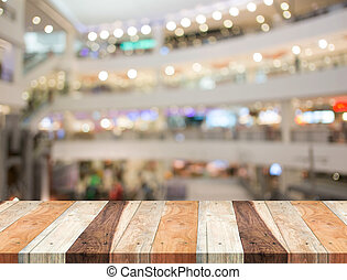 Empty wood table and blurred shopping mall background. product display template.Business presentation.