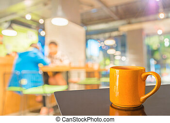Empty wood table and Coffee shop blur background with bokeh...