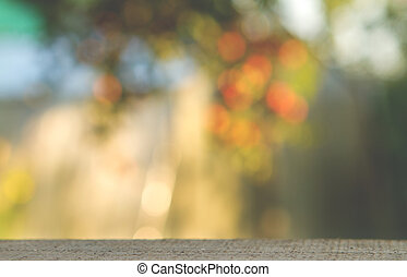 wood table over blurred trees with bokeh background