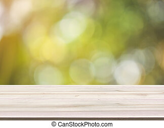 Empty Wood table top with blurred green bokeh background, for product display montage.
