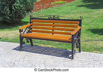 empty wooden bench in the green park