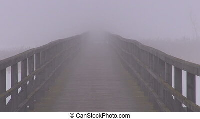 empty wooden bridge and fog - empty wooden bridge on winter...