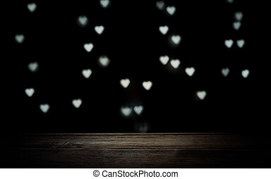 wooden brown texture on dark background with glowing hearts