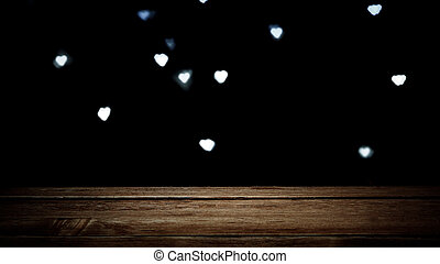 Empty wooden brown texture on dark background with glowing hearts