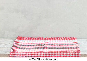 Empty wooden desk table and red checked tablecloth over mint wallpaper background