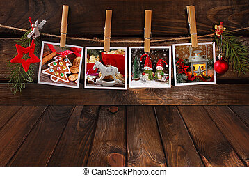 empty wooden floor and christmas photos hanging on twine -...