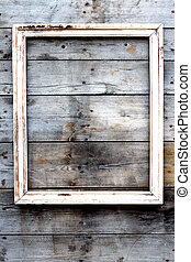 Empty wooden frame on a grunge background