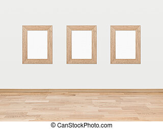 Empty wooden frames on a white wall