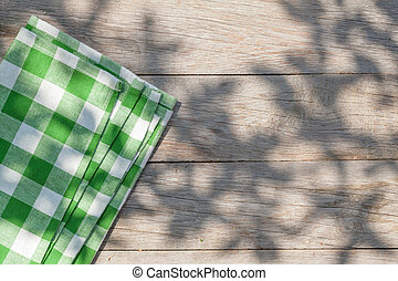 Empty wooden garden table with tablecloth