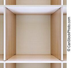 empty wooden locker - empty wooden shelves in department...