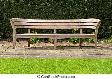 Empty wooden park bench, Avebury manor