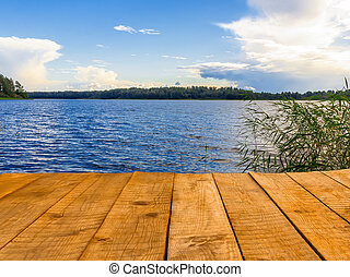 Empty wooden pier for swimming, boats or fishing on the lake