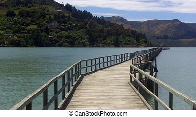 Empty wooden pier in Lyttelton, New Zealand