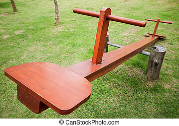 Empty wooden seesaw in a park