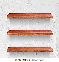 empty wooden shelf on white wall
