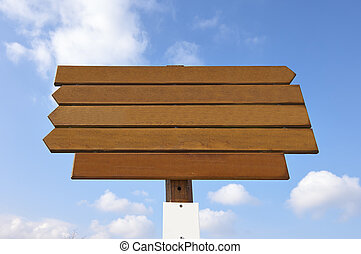 empty wooden sign on blue sky background