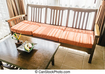 Empty wooden sofa and chair