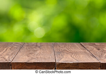 Empty wooden table against green background - Empty wooden...