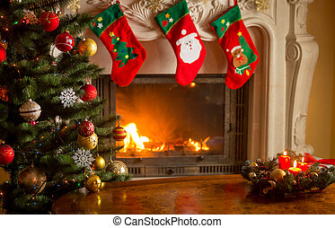 Empty wooden table in front of decorated fireplace and...