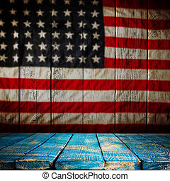 Empty wooden table over vintage USA flag background. Ready...