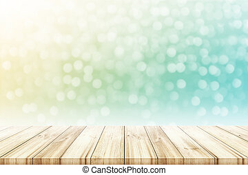 Empty wooden table top with blurred color light bokeh circle background.