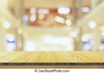 Empty wooden table with a blurred background