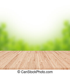 Empty wooden table with blurred garden on background