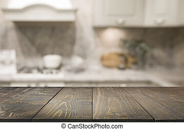 Empty wooden tabletop and defocused rustic kitchen for design and display your products. Abstract background.
