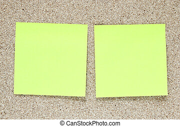 Empty yellow note paper on cork board