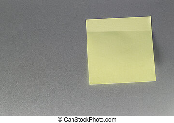 Empty yellow paper sheet on refrigerator door for design.