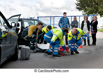 EMS teamwork - A team of emergency medical services at work,...