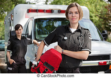 EMS professional with portable oxygen equipment