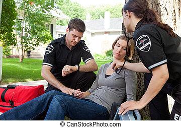 EMT Professionals with Patient - EMT medical professional...