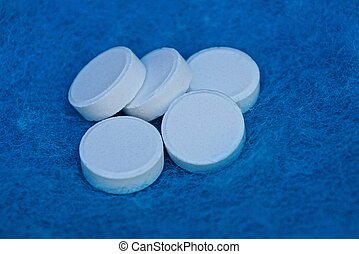 en, bundtet af, hvid, pillerne, på, blå, uld