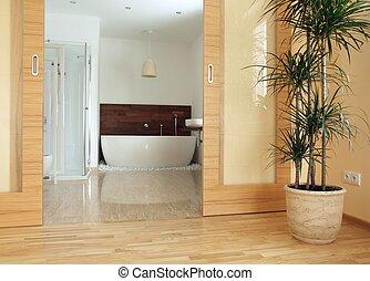 View of a modern en suite bathroom from a bedroom.