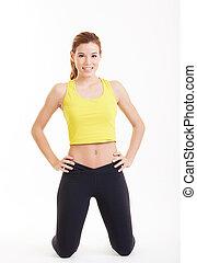 en woman, exercerande, genomkörare, fitness, aerobic övning, abdominals, trycka, ups, ställing, på, studio, isolerat, vit fond