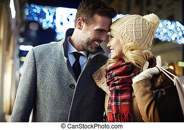 Enamored couple at night time in the town