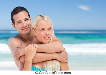 Enamored couple on the beach