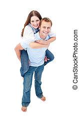 Enamoured couple enjoying piggyback ride