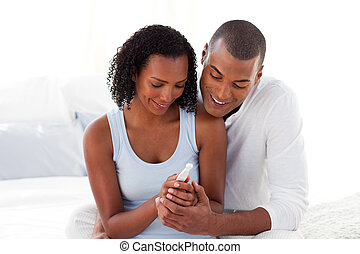 Enamoured couple finding out results of a pregnancy test ...