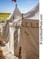 Encampment - a picturesque medieval tent during a medieval...