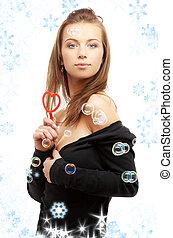 encantador, menina, com, heart-shaped, soprador, e, snowflakes