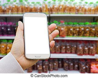 encas, fond, vente, supermarché, pull-over, conditionnement, téléphone, fait, produits, asiatique, tenant main, agricole, brouillé, stand., intelligent, gauche
